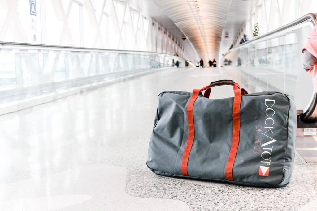 travel with a dockatot transport bag in airport