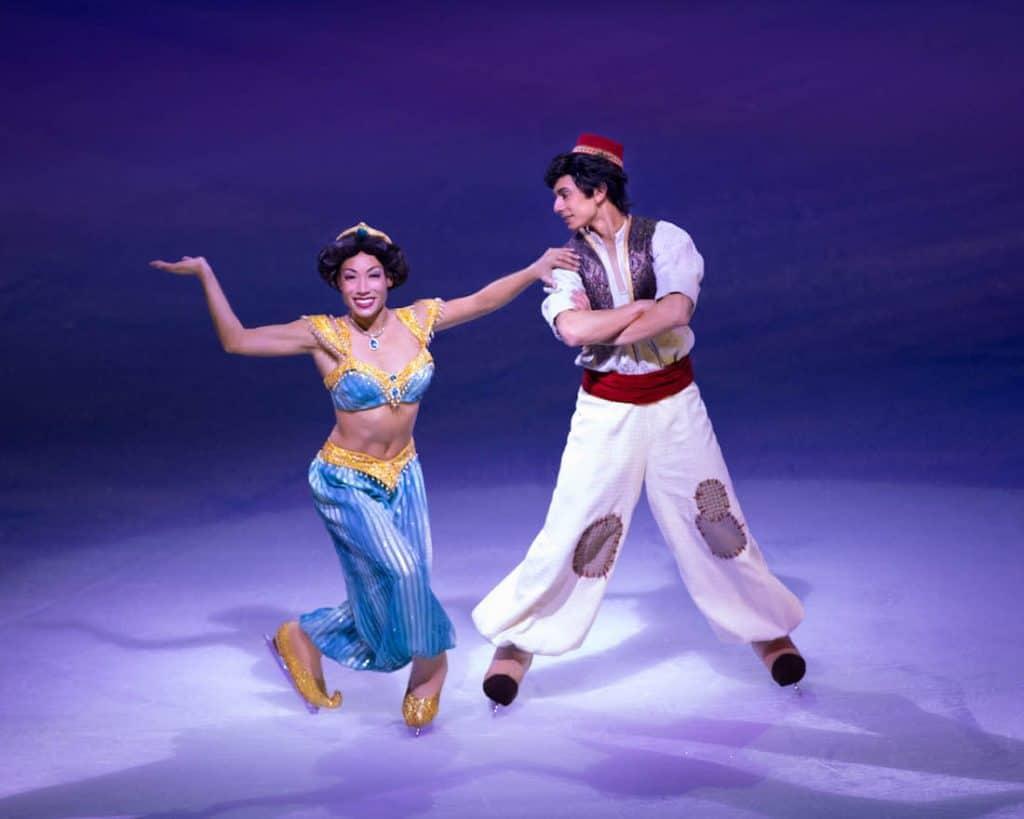 Aladdin Disney character ice skaters perform.