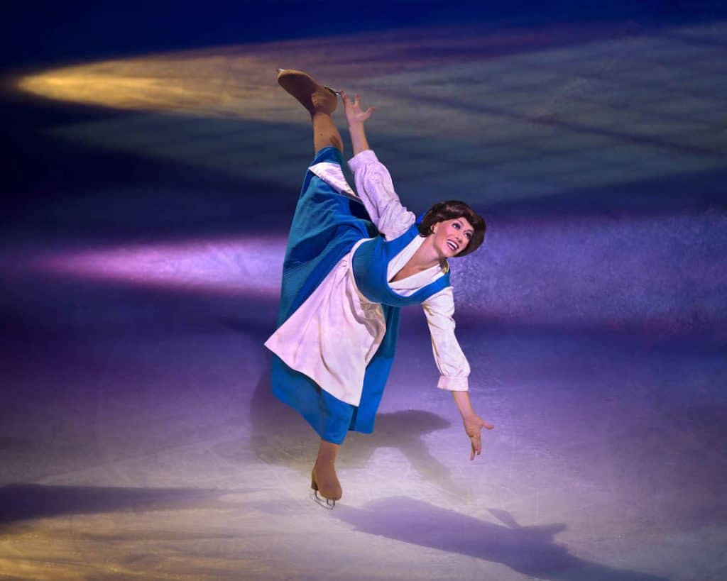 Women dressed as Disney character skates on ice.