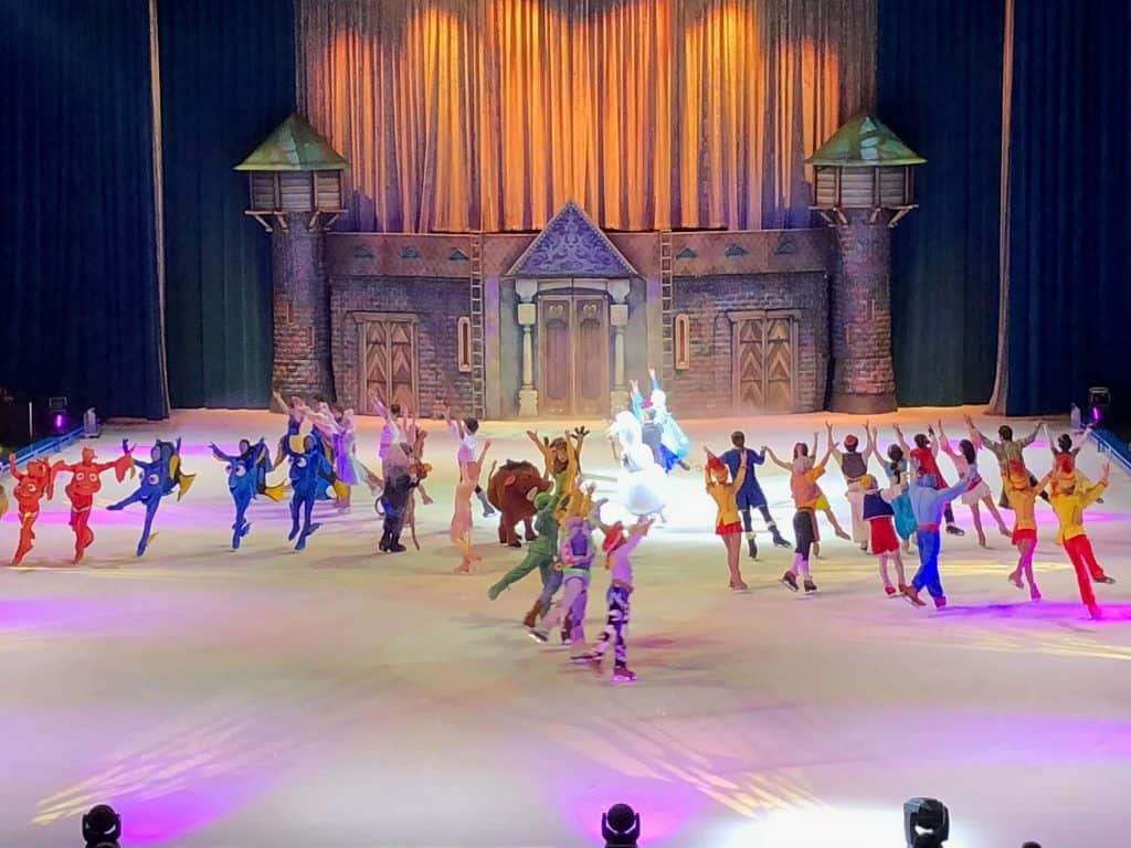 Disney performers skate to music.