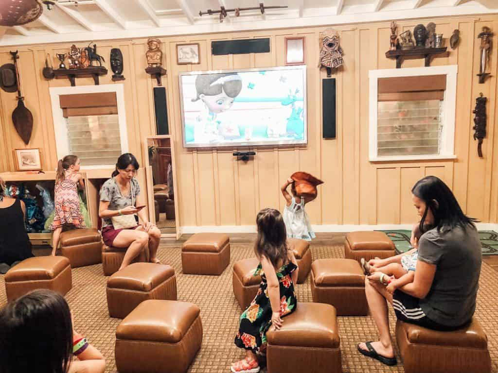 Children watch TV show at resort for Disney.