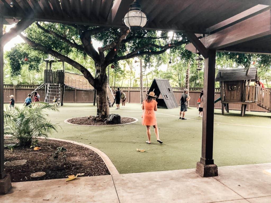 Children play on playground at Disney resort in Hawaii.