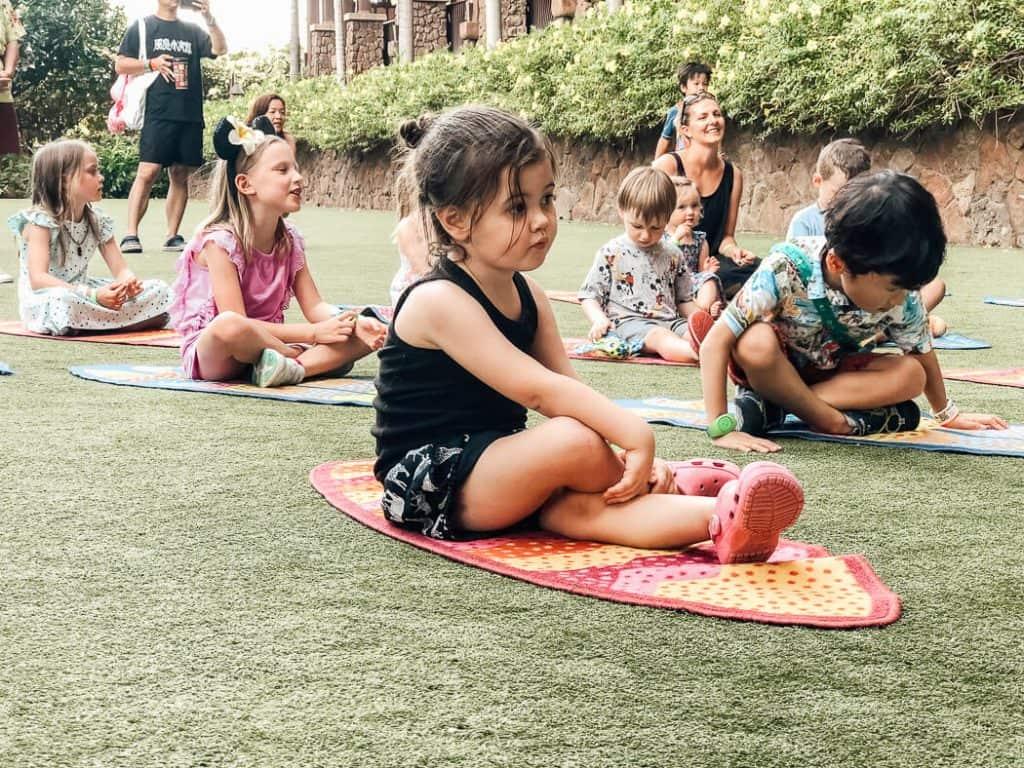 Children participate in group outdoor activity at Disney resort.