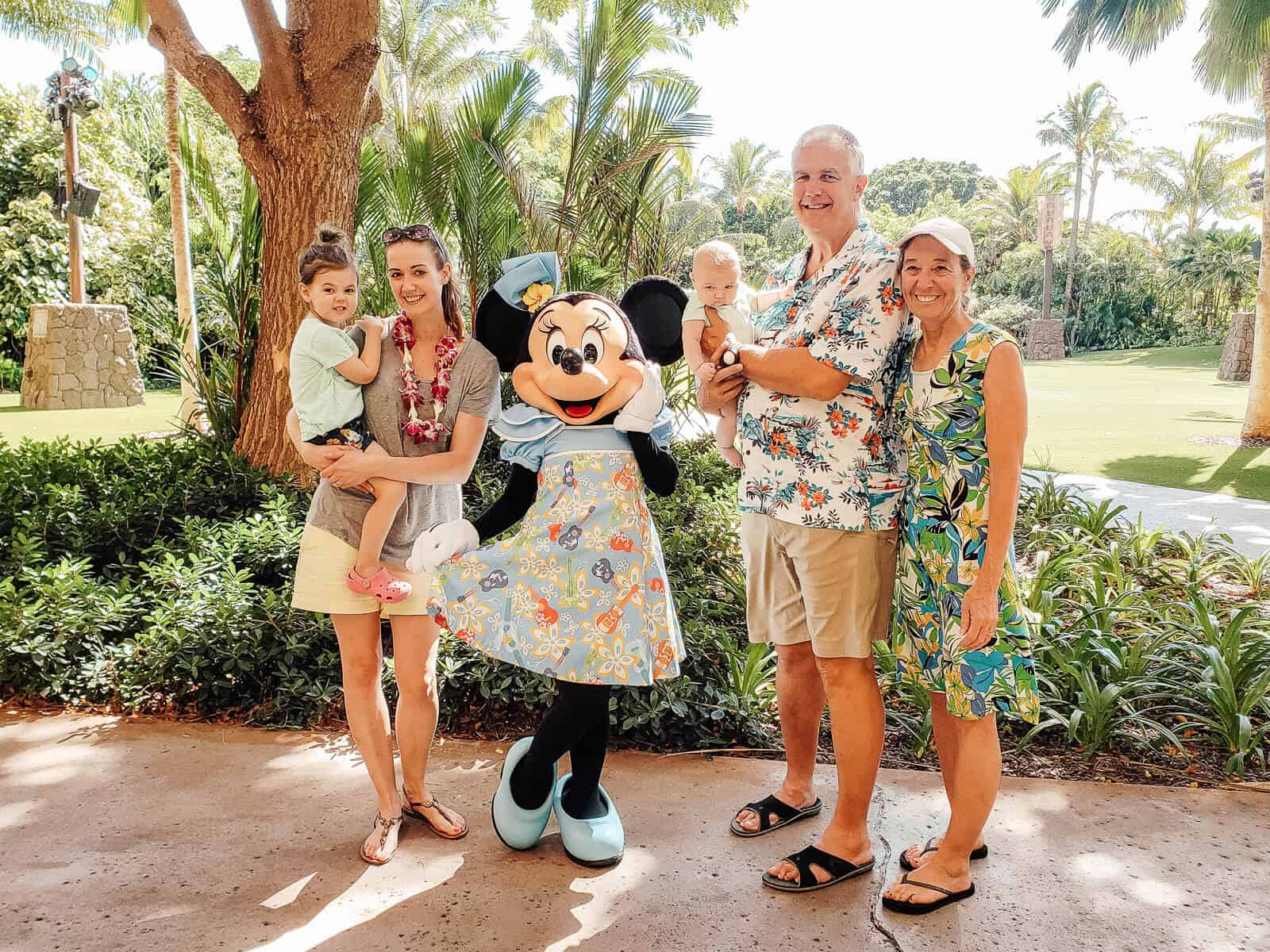 Family with baby and toddler with Minnie Mouse at Disney Aulani Resort in Oahu