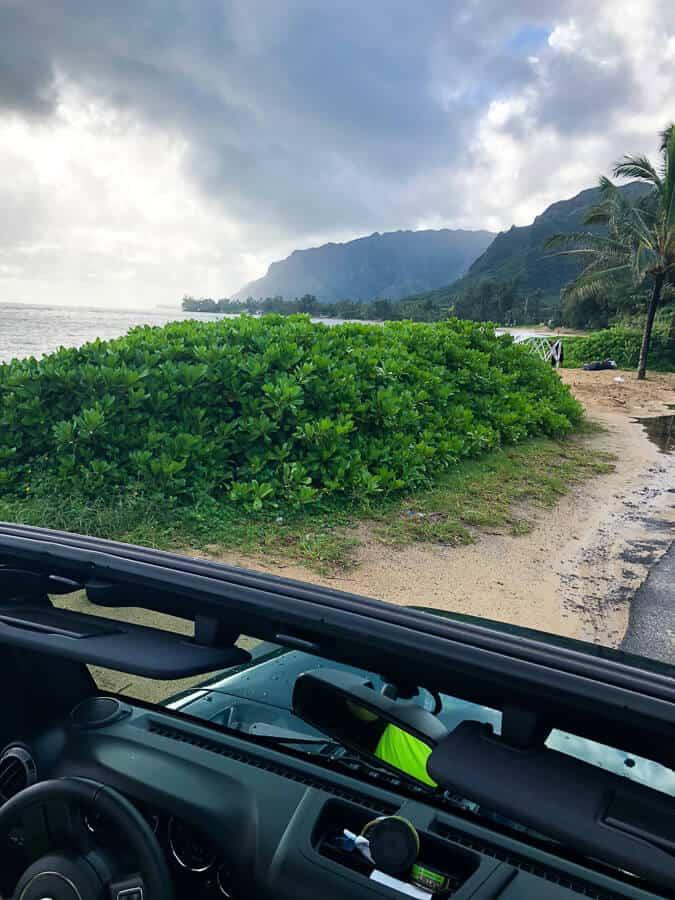View through vehicle windshield of Hawaiian ocean.