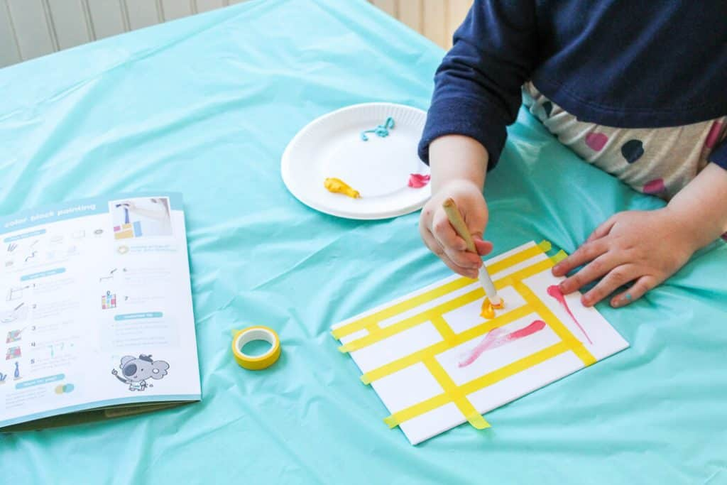 Girl makes art deign using products for spring for kids and moms.
