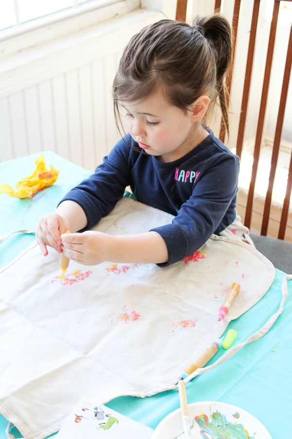 Girl decorates using spring products for kids and moms.