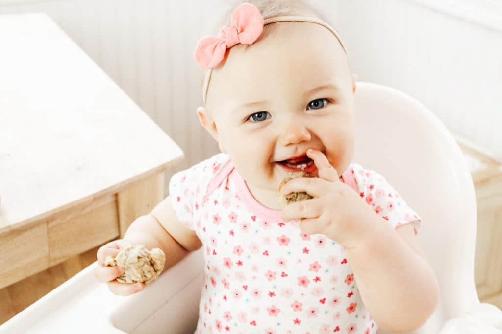 Baby eats muffins for baby led weaning.