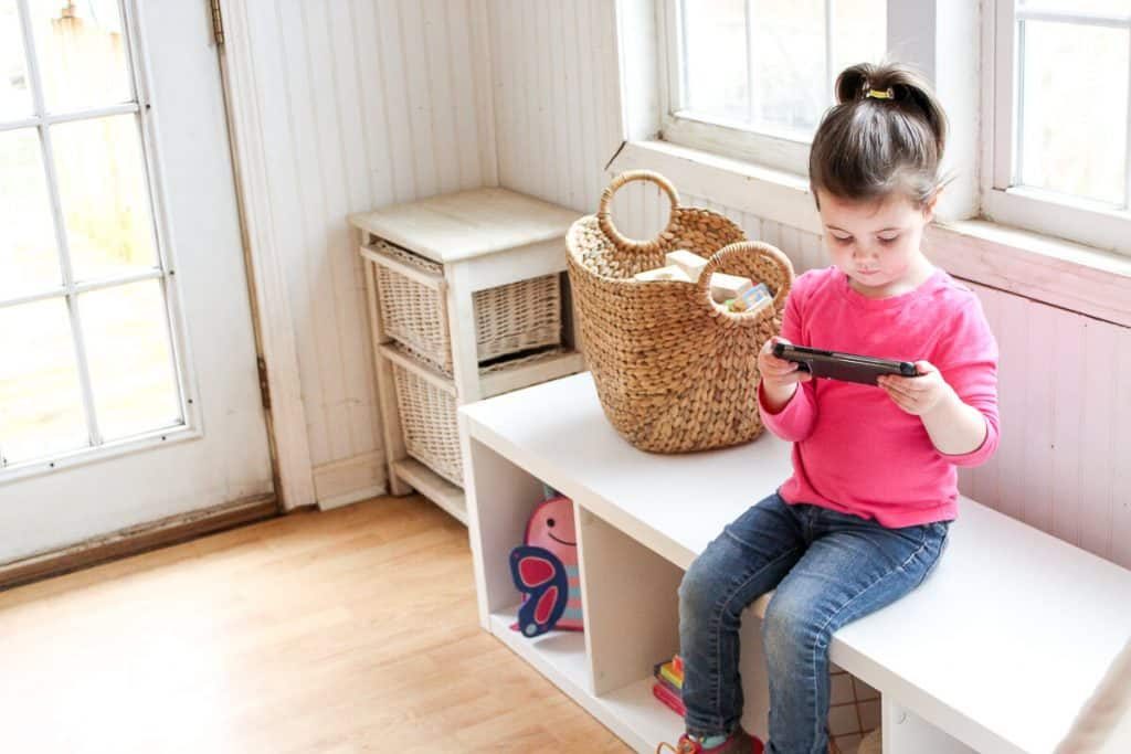 Girl consumes digital content on tablet.