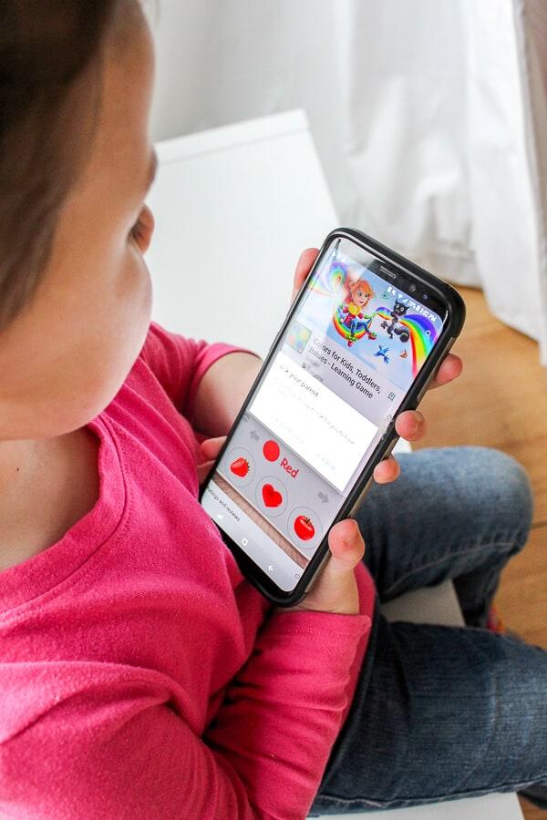 Child plays on smartphone.