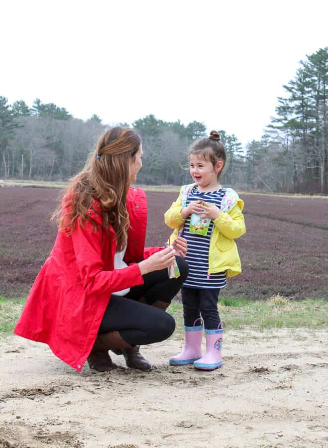 Mom and Girl with Ocean Spray Growing Goodness Juice drink at cranberry bog