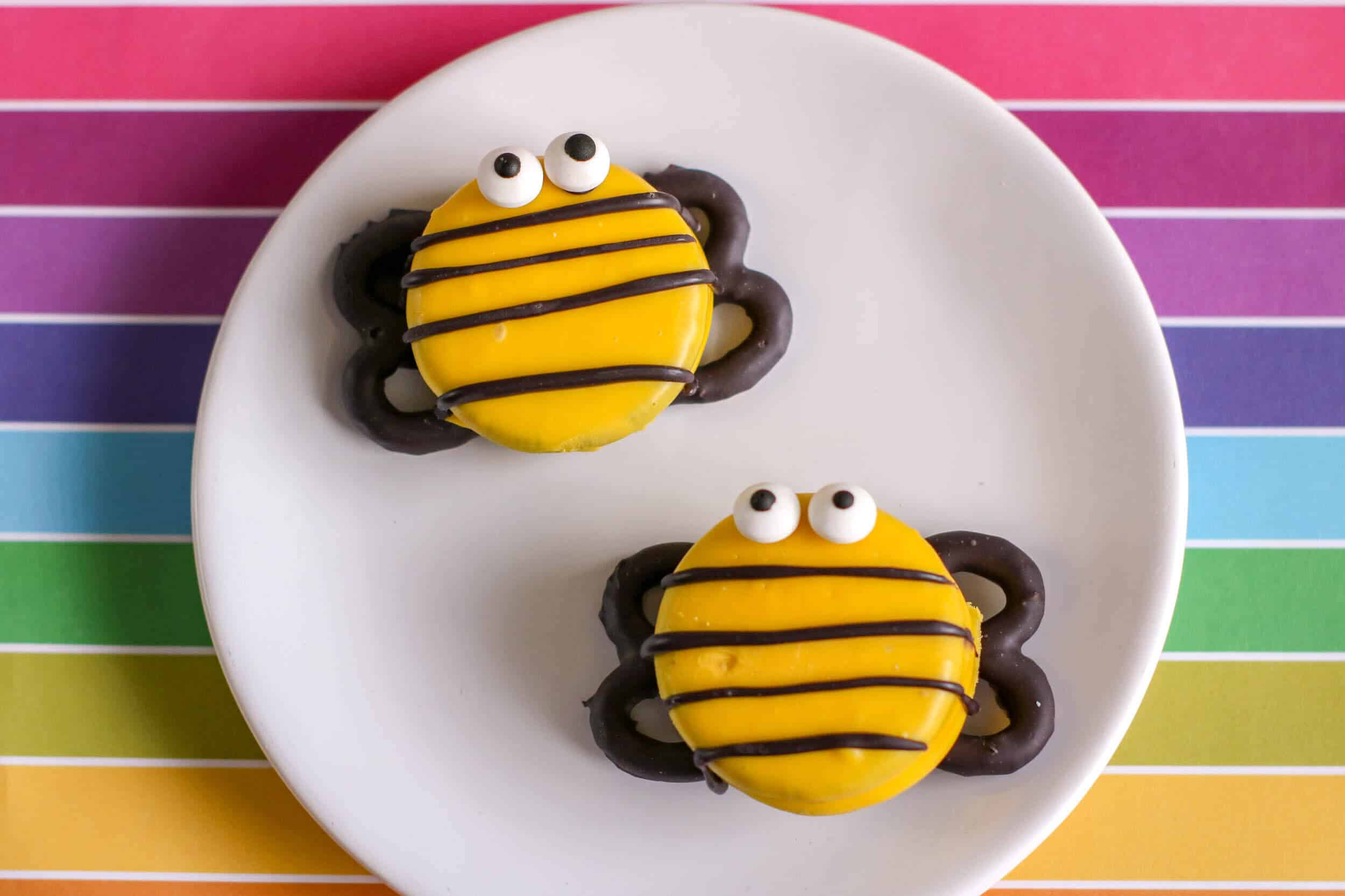 Bee decorated cookies on plate.
