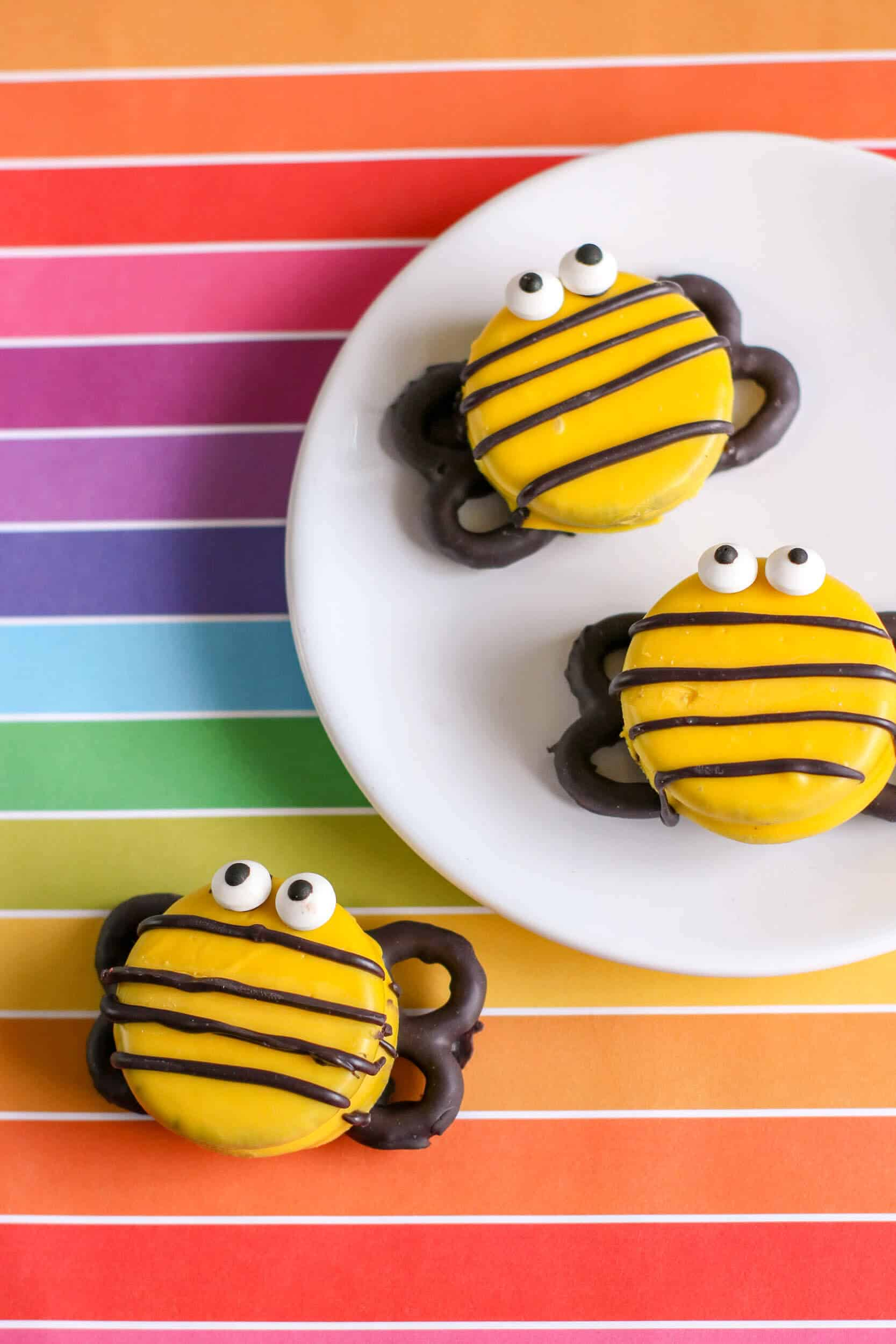 DIY bee themed party food on white plates.