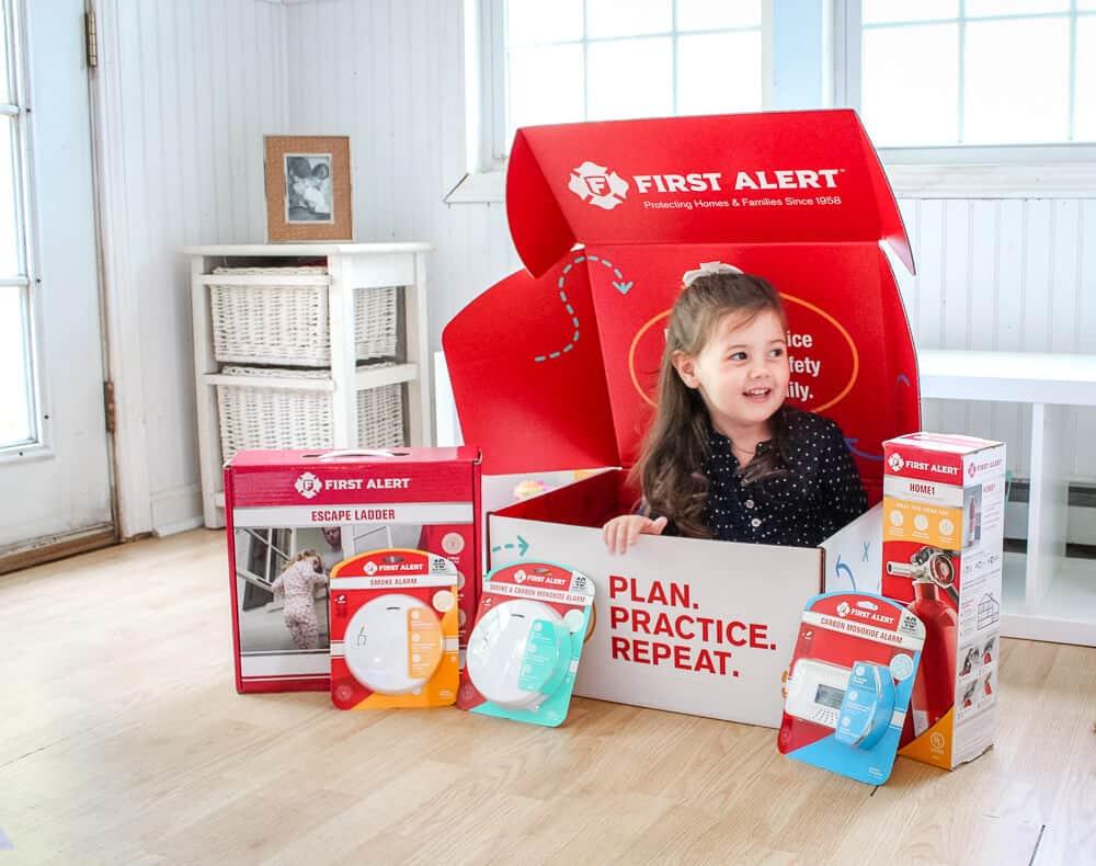 Child plays in First Alert emergency plan box.