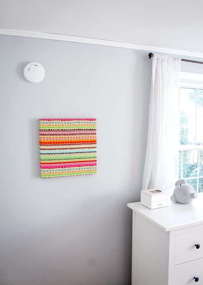 Smoke detector on wall in bedroom.