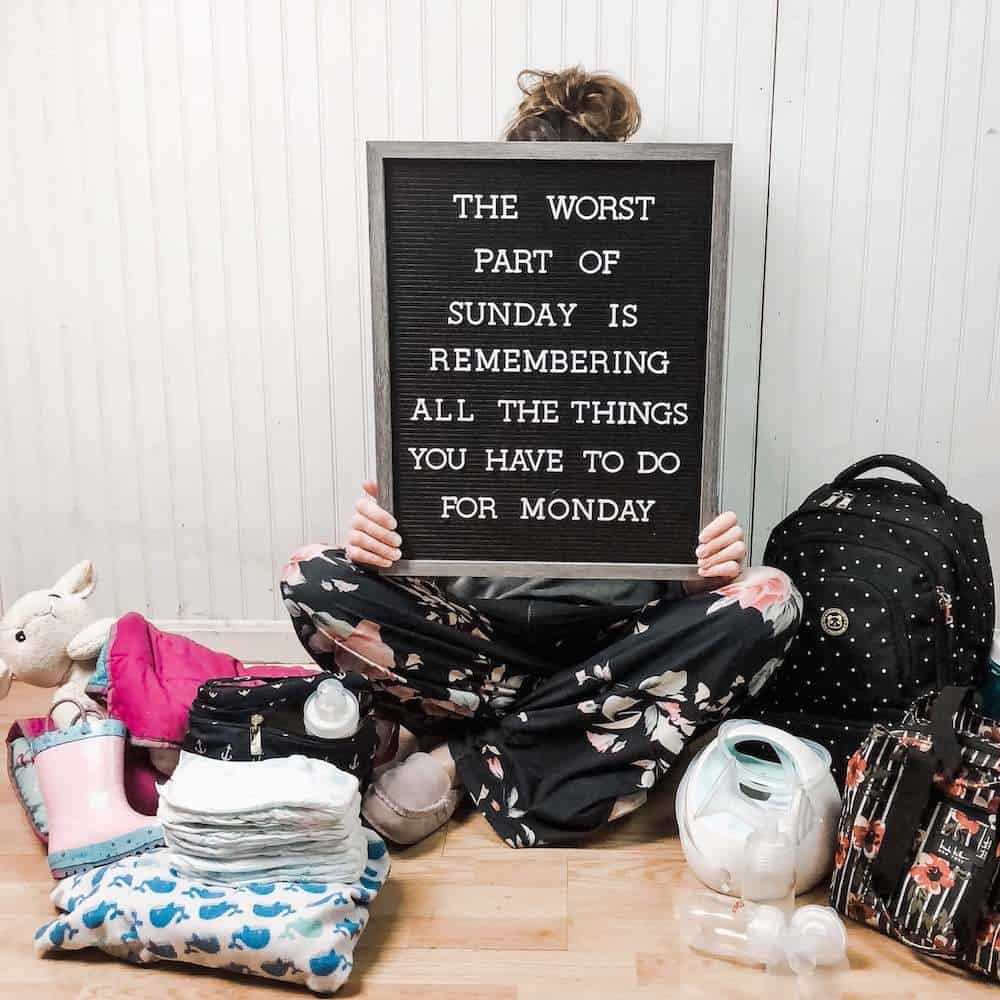Mom holding letterboard that says the worst part of sunday is remembering all of the things you have to do for Monday