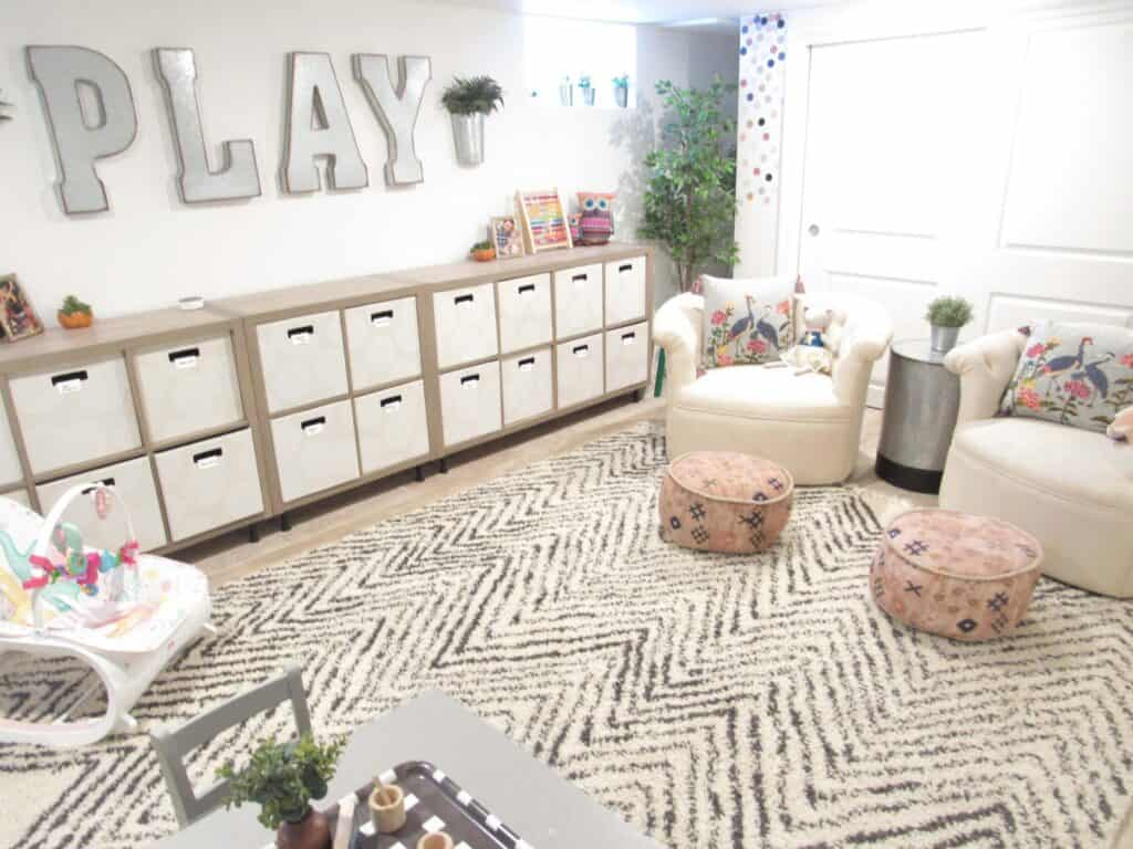beautiful modern farmhouse playroom with words play on wall