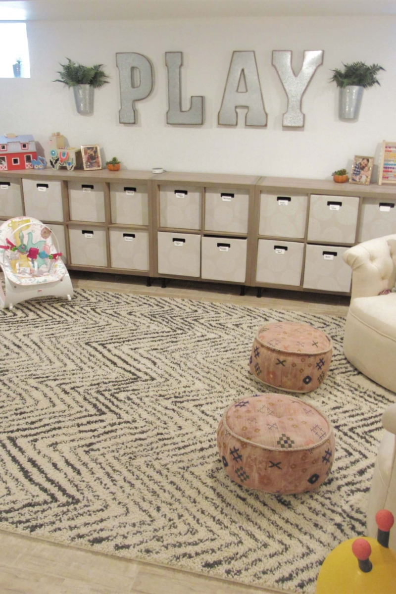 modern playroom decor and toy storage with galvanized PLAY sign