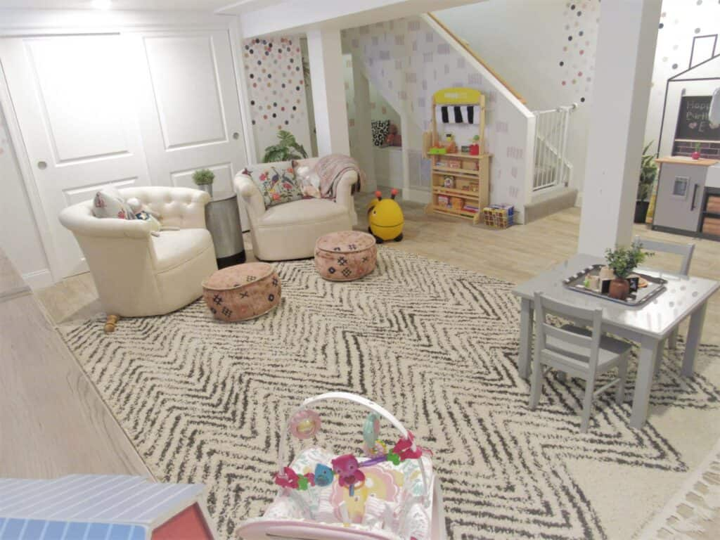 neutral playroom with chairs and kids table