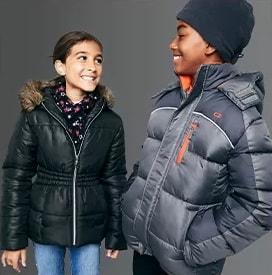 Children wearing puffer jackets from Macys.