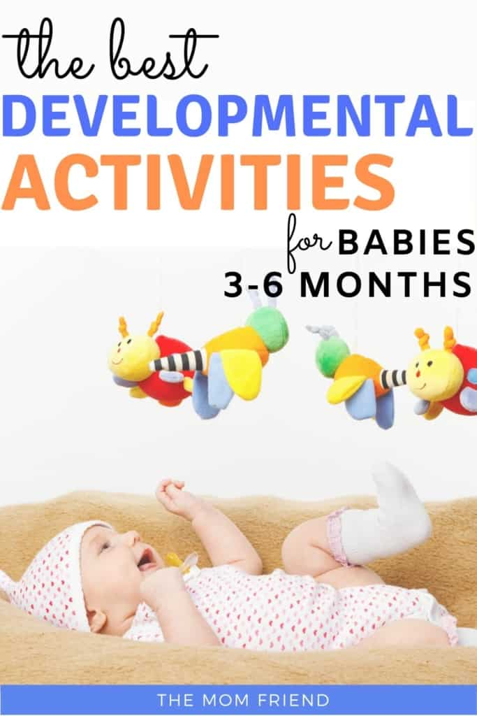baby playing with toy hanging above it with text the best developmental activities for babies 3-6 months