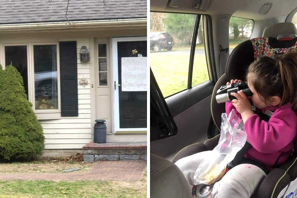Child uses binoculars to search for bears during neighborhood bear hunt.