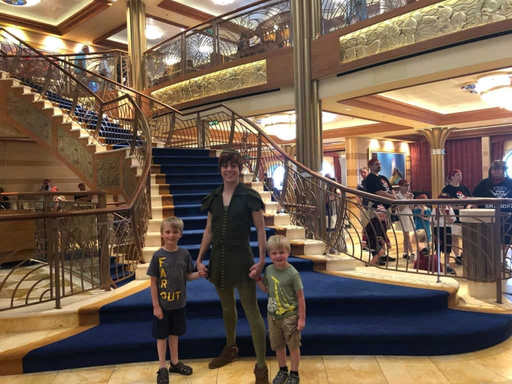 Peter Pan with boys on Disney Dream in front of staircase