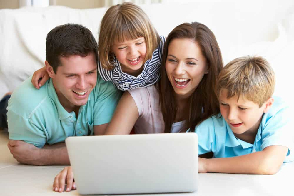 family happy at the computer