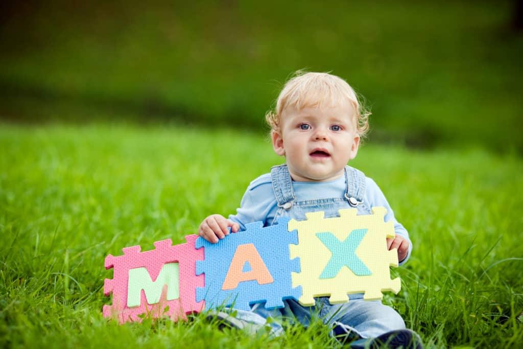 "Boy holds foam letters, spelling ""Max"""