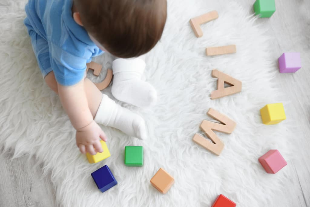 Baby boy with blocks that spell, Liam, from Handsome Boy Names list.