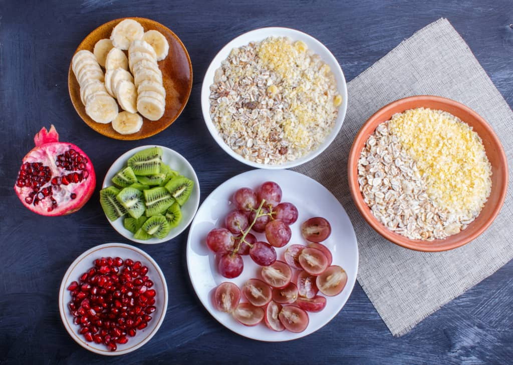 healthy snacks for toddlers spread out including fruit and oatmeal