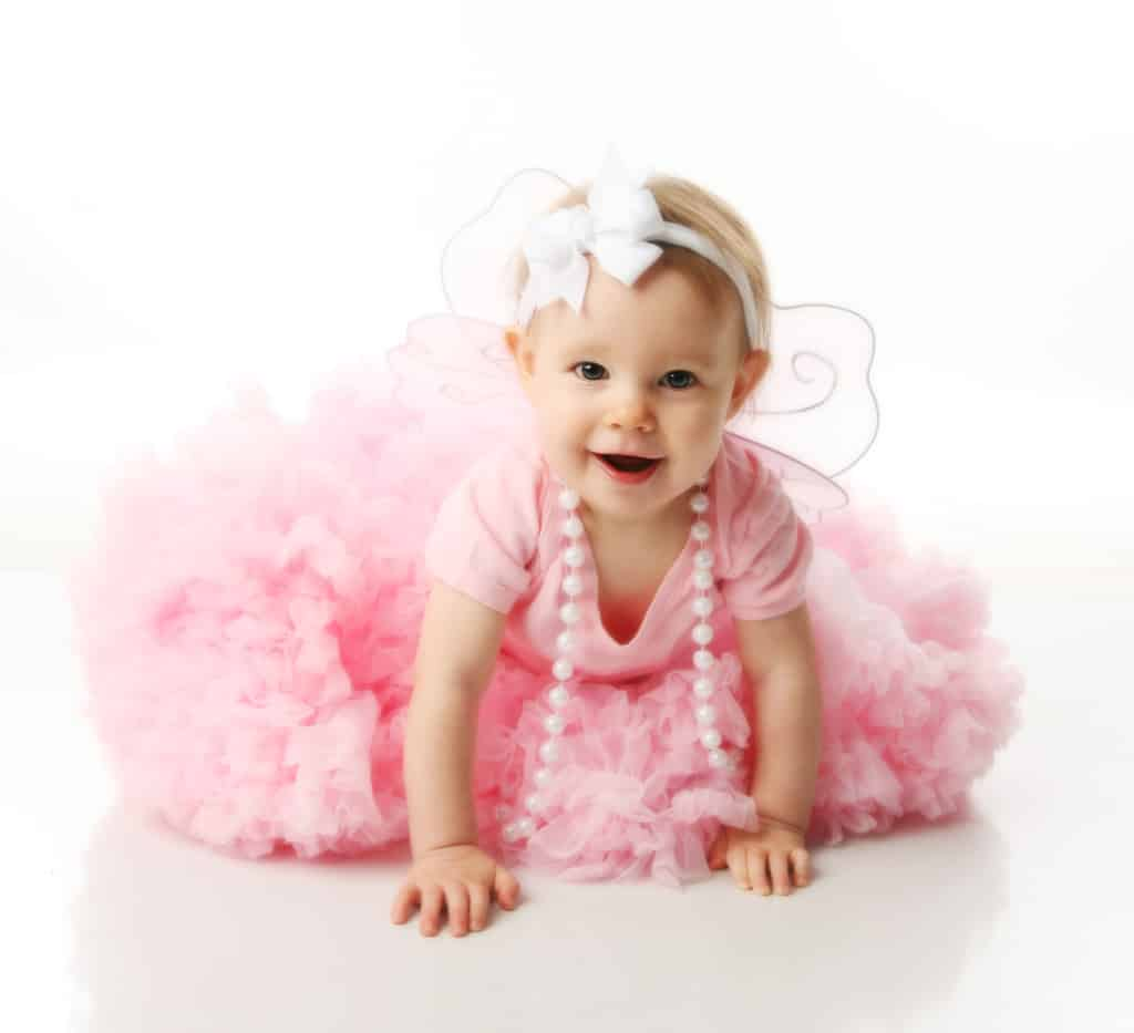 Baby in pink tutu and fairy wings.