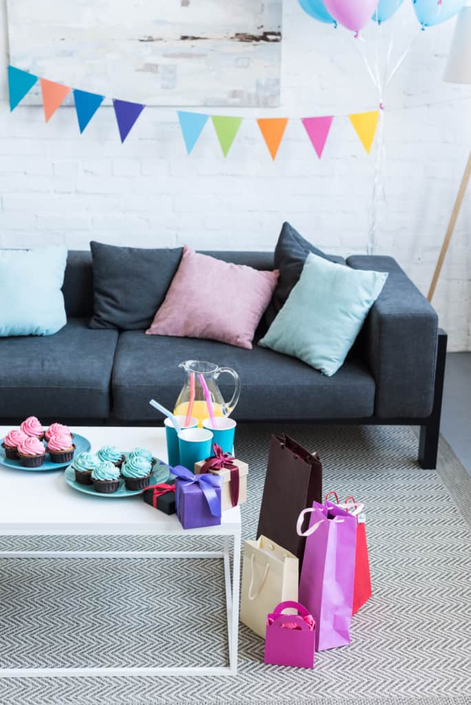 Living room decorated for gender reveal party.