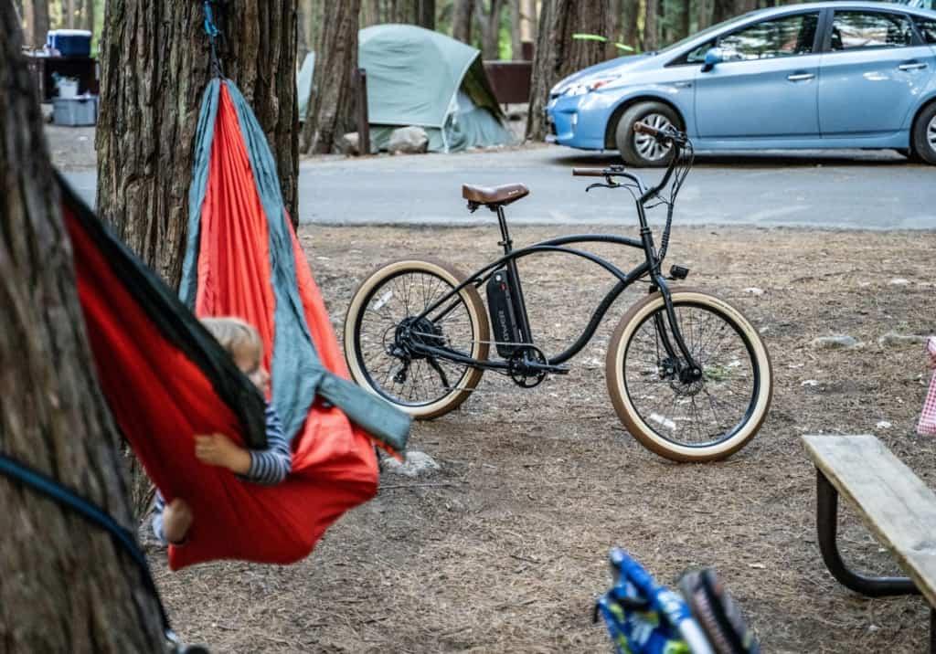 child in hammock at campsite