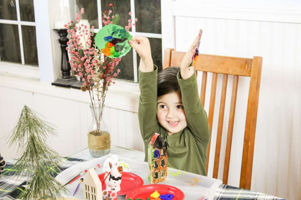little girl making simple christmas crafts