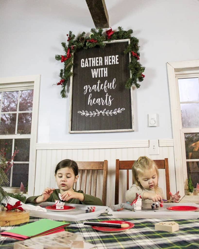 christmas decor large sign with girls crafting
