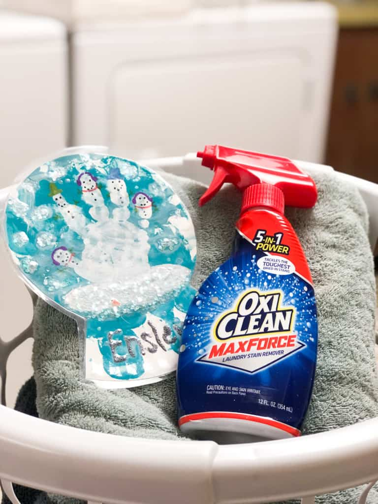 baskest with towels, an easy christmas craft and a bottle of oxiclean max force spray