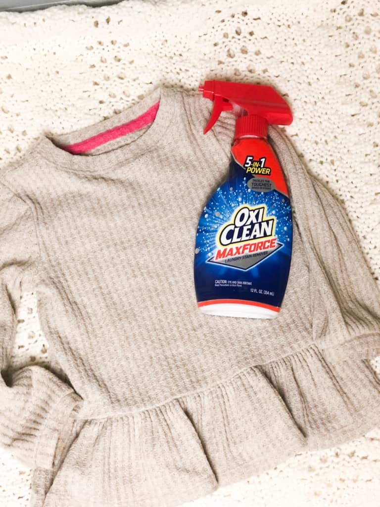 clean shirt with bottle of oxi clean