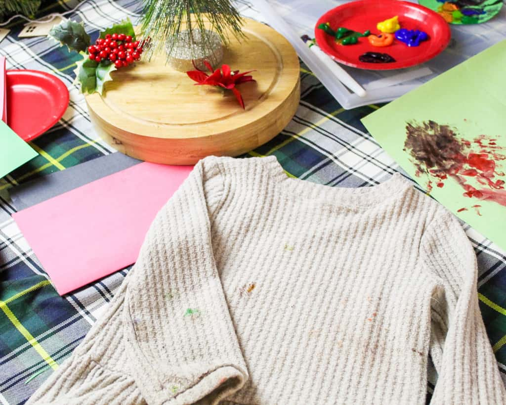 christmas craft supplies with stained shirt