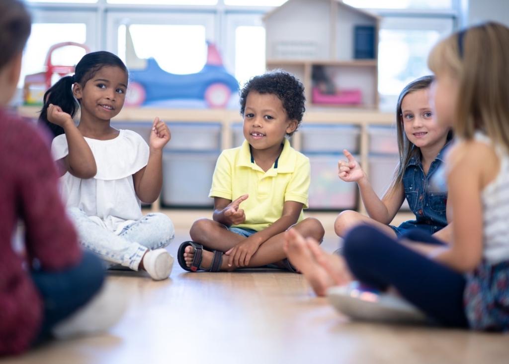 Children play a game at preschool.