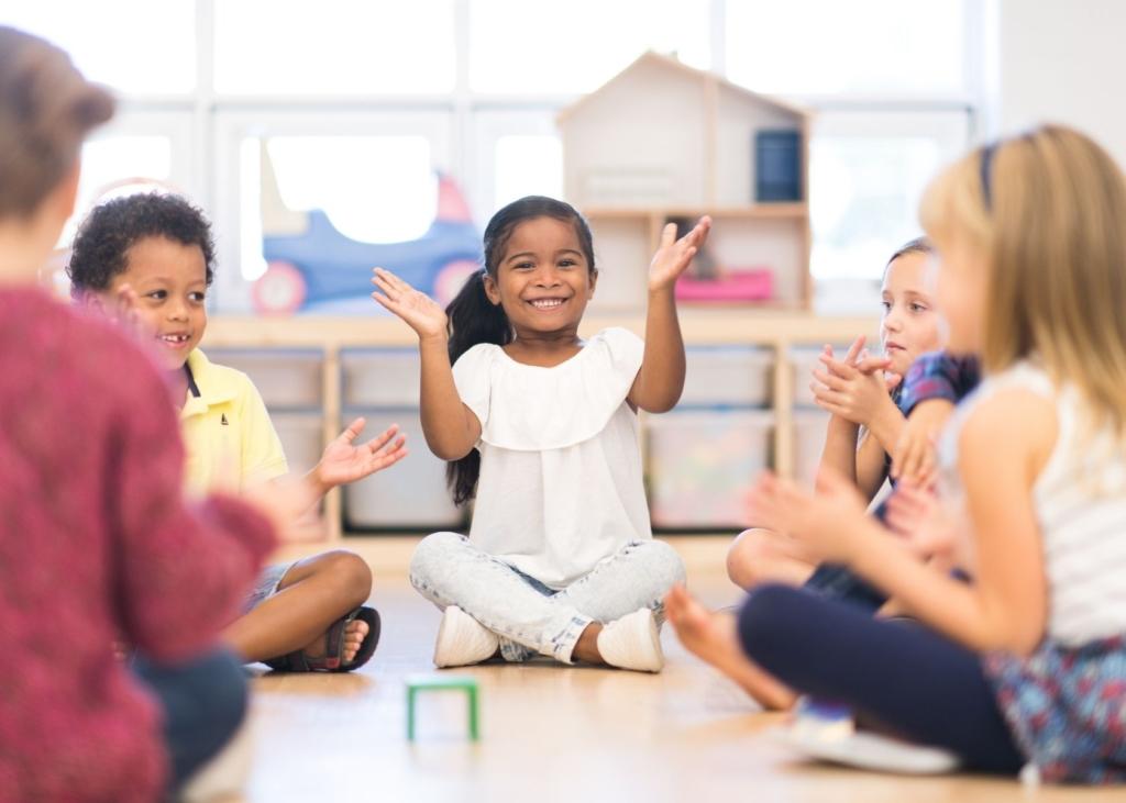 Children play circle time games at preschool.
