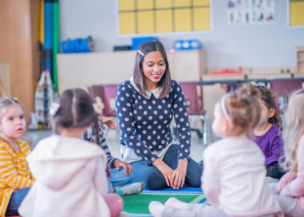 Teacher leads circle time at school.