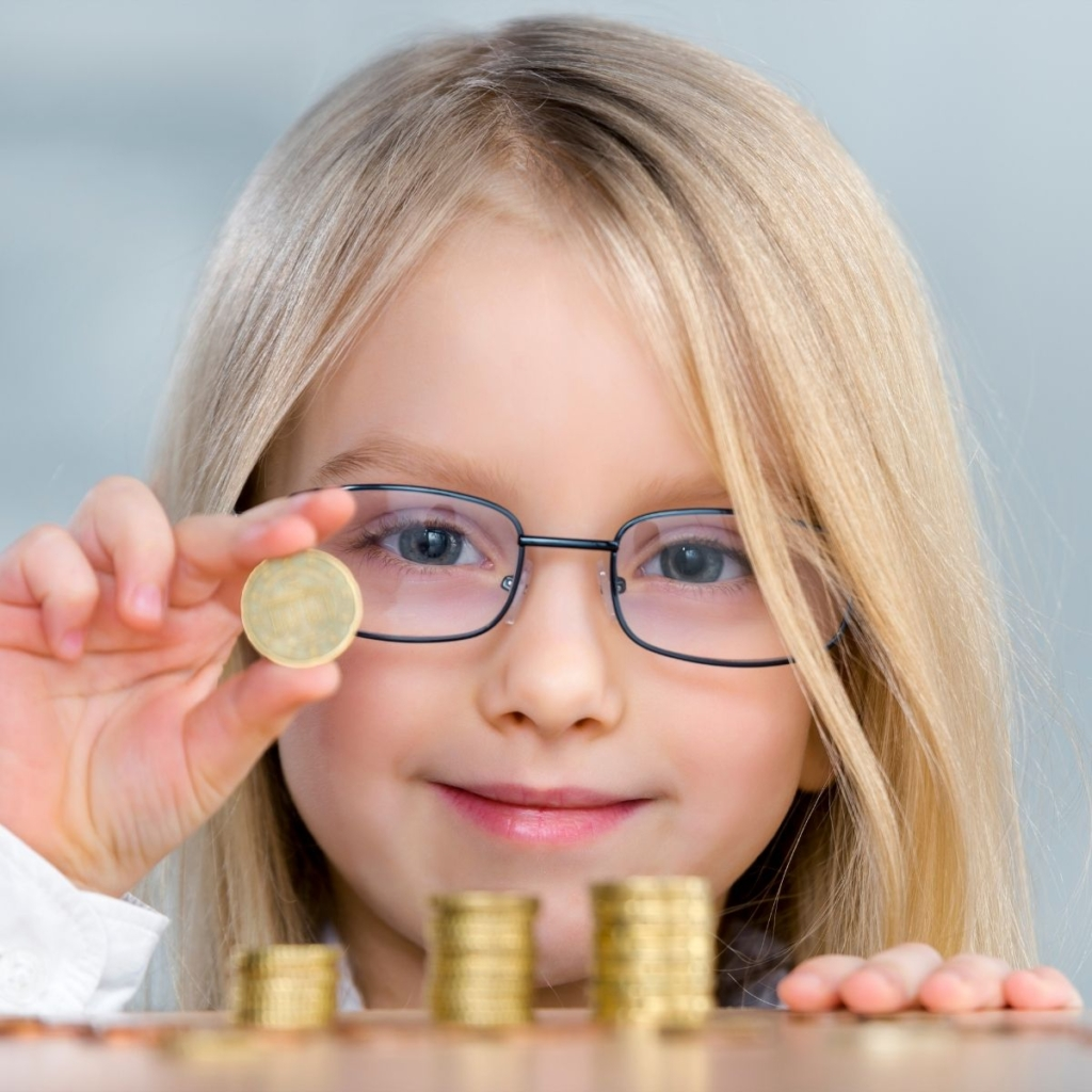 Girl counting coins.