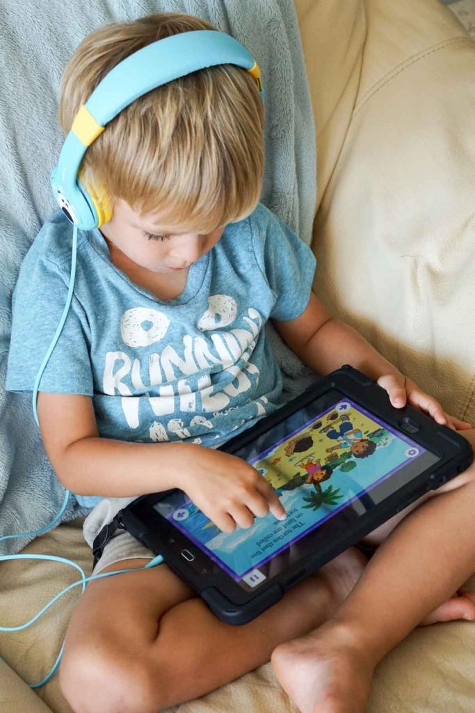 Preschooler using noggin app on a tablet.