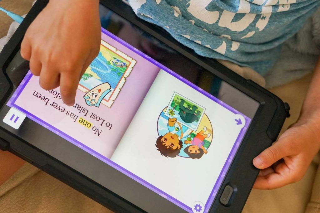 Preschooler reading ebook.