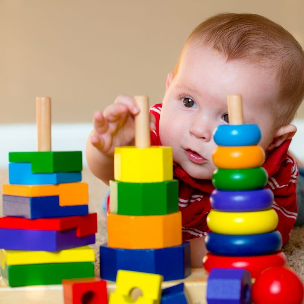 Baby plays with donated toys.