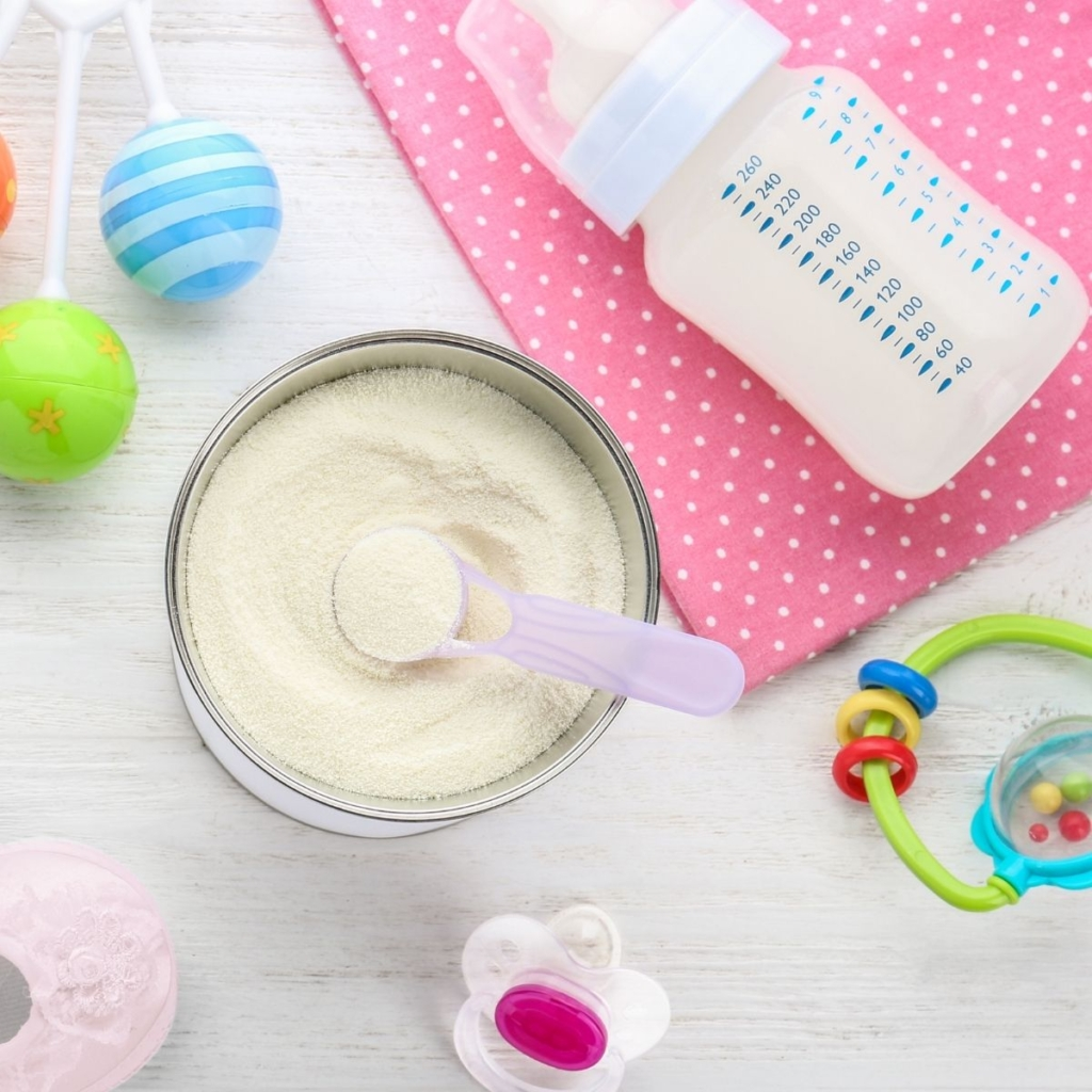 Baby formula container with scoop.