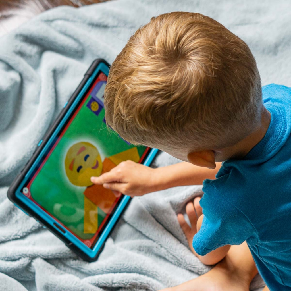 Little boy playing on a tablet.