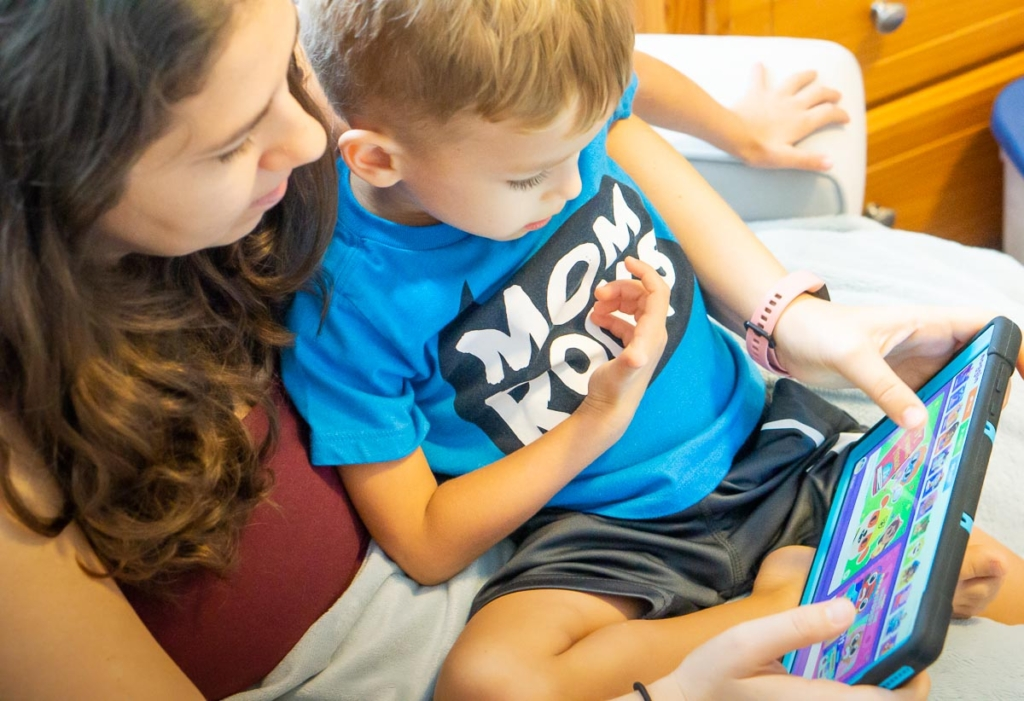 Mom and boy watching a tablet.