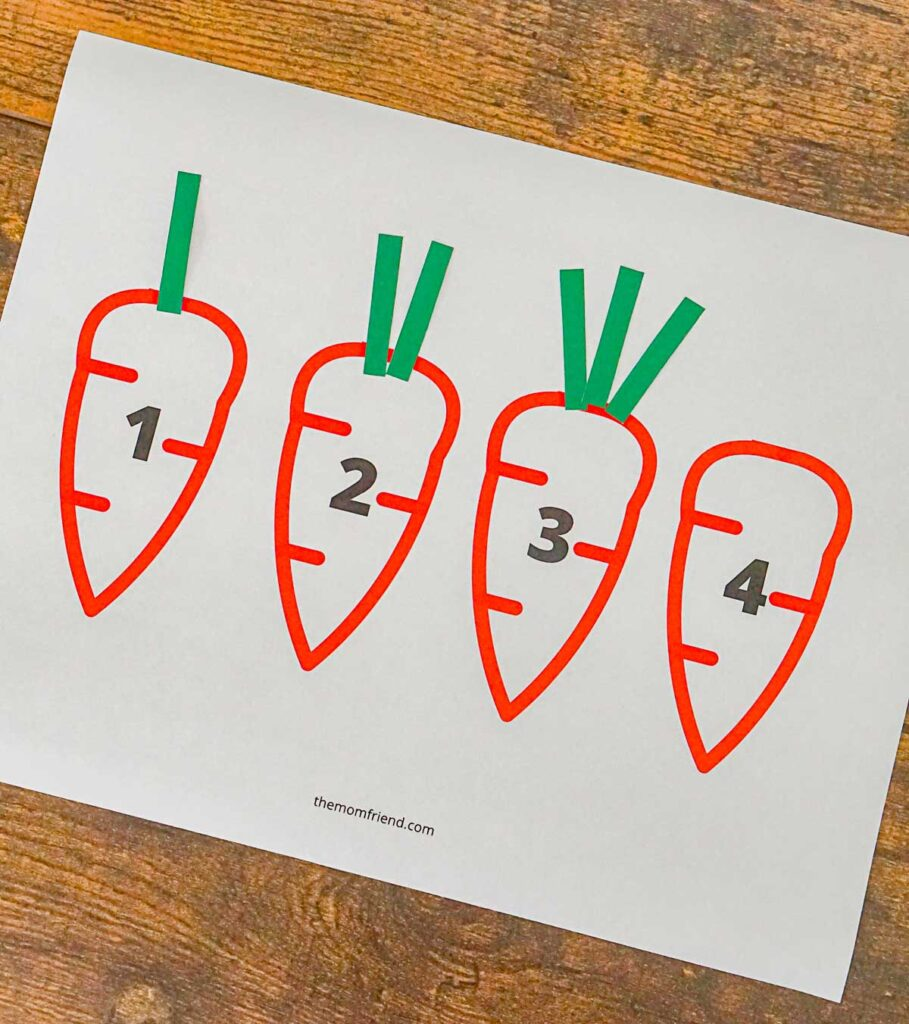 Printable counting activity where kids add the correct number of carrot tops to a picture of a carrot.